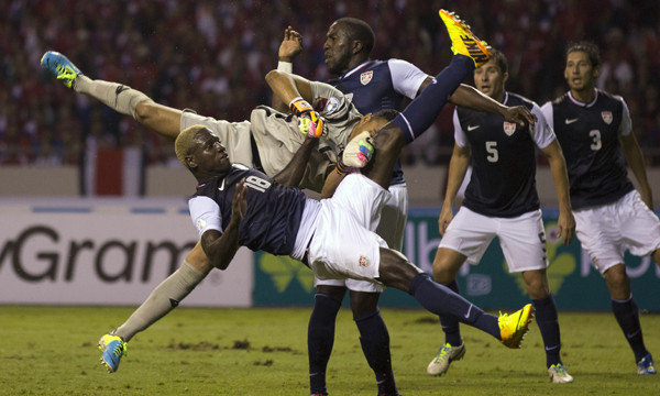 Both Eddie Johnson (falling) and Jozy Altidore (behind the goalkeeper started the game on the bench. (Photo: Moises Castillo / Associated Press / September 6, 2013)